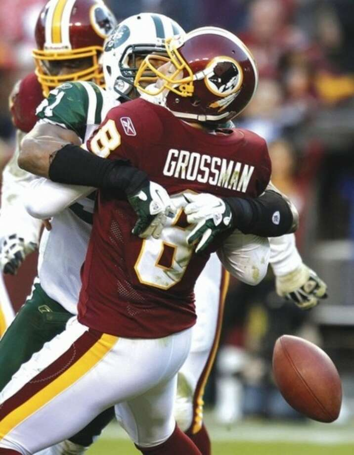 AP photo Aaron Maybin of the New York Jets sacks Washington Redskins quarterback Rex Grossman, forcing a fumble during the second half of Sunday's game. The Jets won, 34-19.