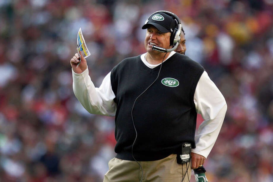 New York Jets coach Rex Ryan reacts to a play during the second half of an NFL football game against the Washington Redskins in Landover, Md., Sunday, Dec. 4, 2011. (AP Photo/Evan Vucci) / AP