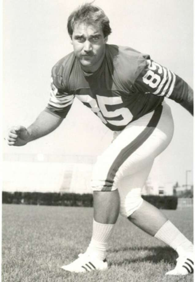 Photo courtesy of UConn Athletic CommunicationsNorwalk's Dewey Raymond, seen in his playing days, will be one of the honorary captains for this Saturday's Blue-White game at the University of Connecticut.