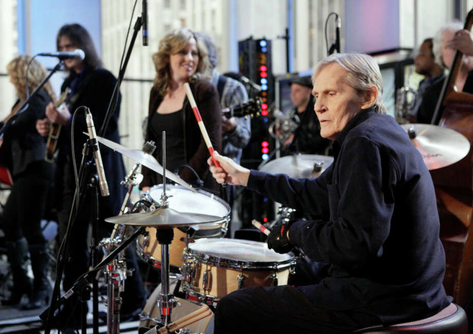 "FILE - In this Oct. 9, 2009 file photo, Levon Helm, right, performs with his band on the ""Imus in the Morning"" program on the Fox Business channel, in New York. At center is his daughter Amy Helm. Helm, who was in the final stages of his battle with cancer, died Thursday, April 19, 2012 in New York. He was 71. He was a key member of The Band and lent his distinctive Southern voice to classics like ""The Weight"" and ""The Night They Drove Old Dixie Down."" (AP Photo/Richard Drew, file) / AP2009"