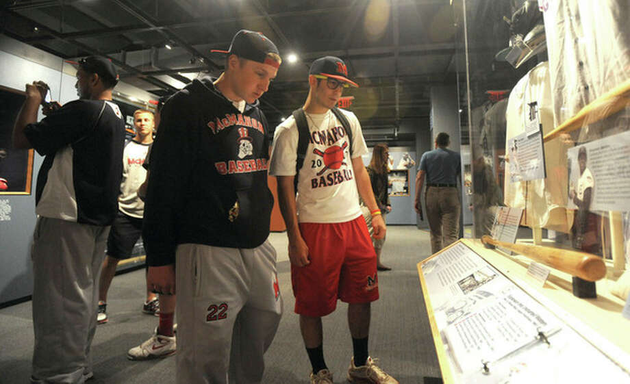 Hour photo/John NashBrien McMahon baseball players Bryan Daniello, right, and Alex Valenzano take a look at a display at the Baseball Hall of Fame Thursday in Cooperstown, N.Y.