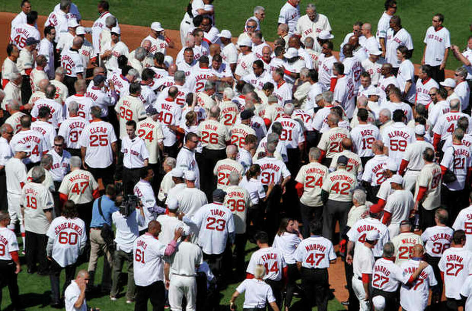 Former Boston Red Sox players, mangers and coaches gather on the field during ceremonies to celebrate the 100th anniversary of the first regular season baseball game at Fenway Park, before a game between the New York Yankees and the Red Sox in Boston, Friday, April 20, 2012. (AP Photo/Michael Dwyer) / AP
