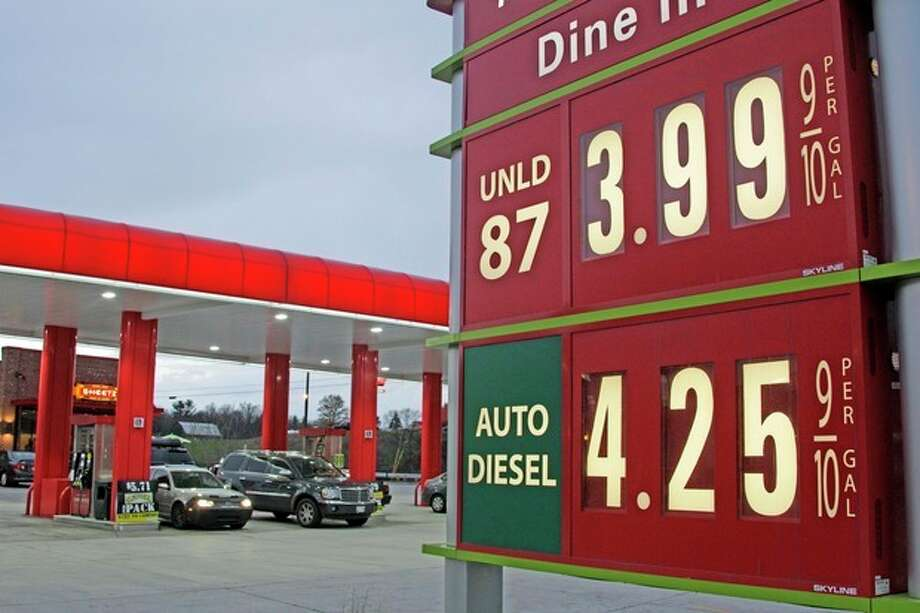 FILE - In this April 9, 2012 file photo, gas prices are posted at a gas station in Breezewood, Pa. Pump prices rose relentlessly from January through April, pushing average gas prices above $3.90 a gallon and taxing families' budgets. Some forecasters expected a $5 peak by the time families got on the road for summer vacations. But prices are expected drop by 10 cents by next week, thanks to a recent drop in oil and wholesale gas prices and frugality at the pump. (AP Photo/Gene J. Puskar) / AP2012
