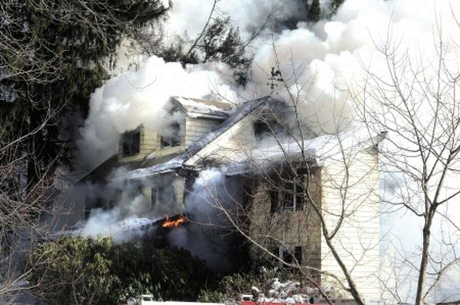 Fire destroys a home on Mill Raod in Stamford Monday afternoon. photo/matthew vinci