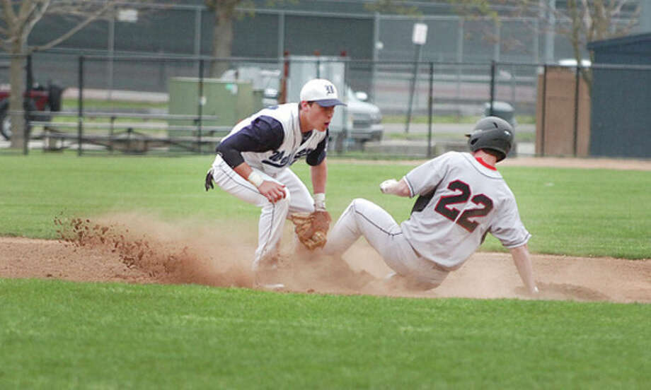 Hour Photo/ Alex von Kleydorff. Wiltons #2 tags out #22 vs Fairfield warde / The Hour Newspapers