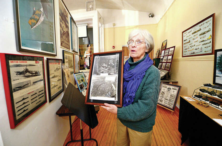 Pat Hegnauer, Georgetown Community Association president, curated the hundreds of magazines, newspapers, photos and propaganda from the World War II era that are on display at the Georgetown Community Association Center, where many of the exhibitions are taken from area Wilton residents' personal collections.Hour photo / Erik Trautmann / (C)2012, The Hour Newspapers, all rights reserved