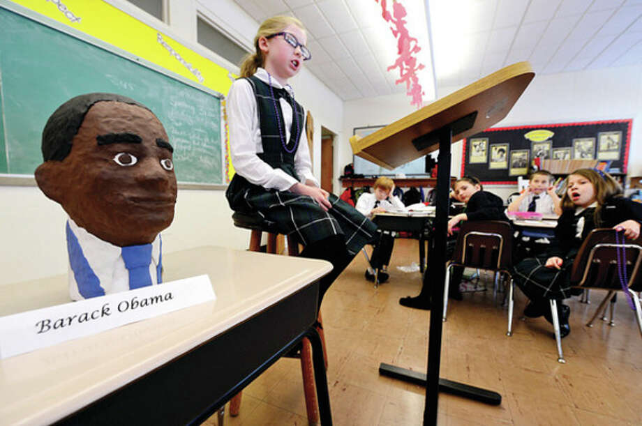 Ella Corry made a bust of historical figure Barack Obama and gives her report in Elizabeth Williams All Saints Catholic School 3rd grade class Tuesday. / (C)2012, The Hour Newspapers, all rights reserved