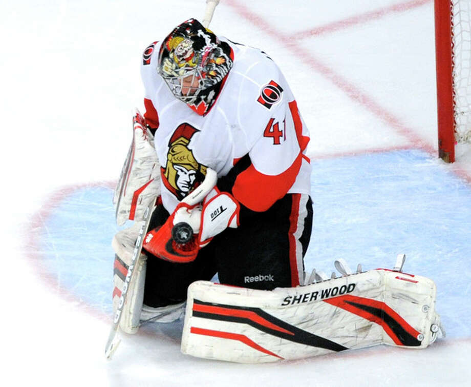Ottawa Senators goaltender Craig Anderson makes a save against the New York Rangers during the second period of Game 5 of an NHL Stanley Cup first-round hockey playoff series, Saturday, April 21, 2012, at New York's Madison Square Garden. (AP Photo/Bill Kostroun) / FR51951 AP
