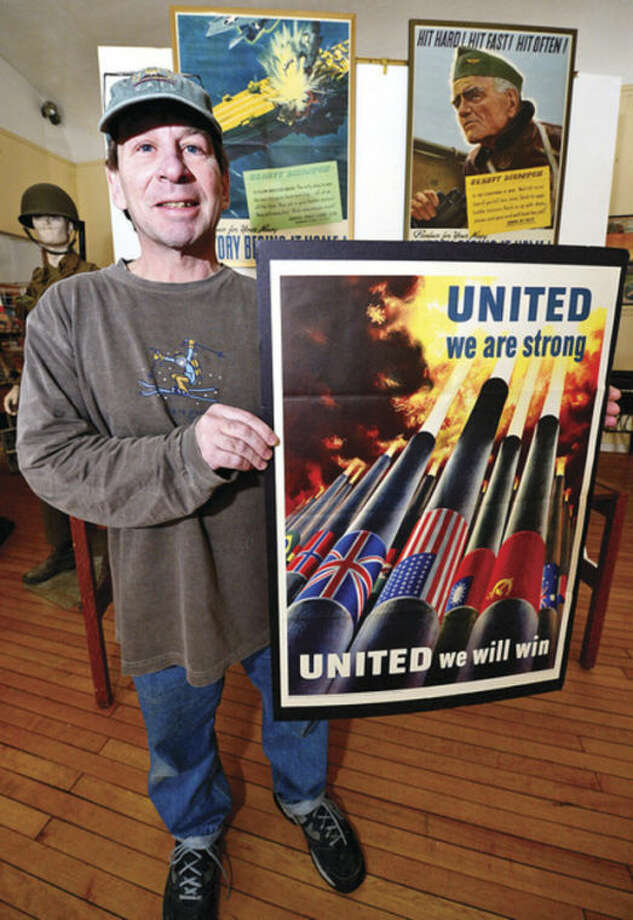 Contributor Roger Raffini helped with the hundreds of magazines, posters, photos and propaganda from the World War II era that are on display at the Georgetown Community Association Center, where many of the exhibitions are taken from area Wilton residents' personal collections.Hour photo / Erik Trautmann