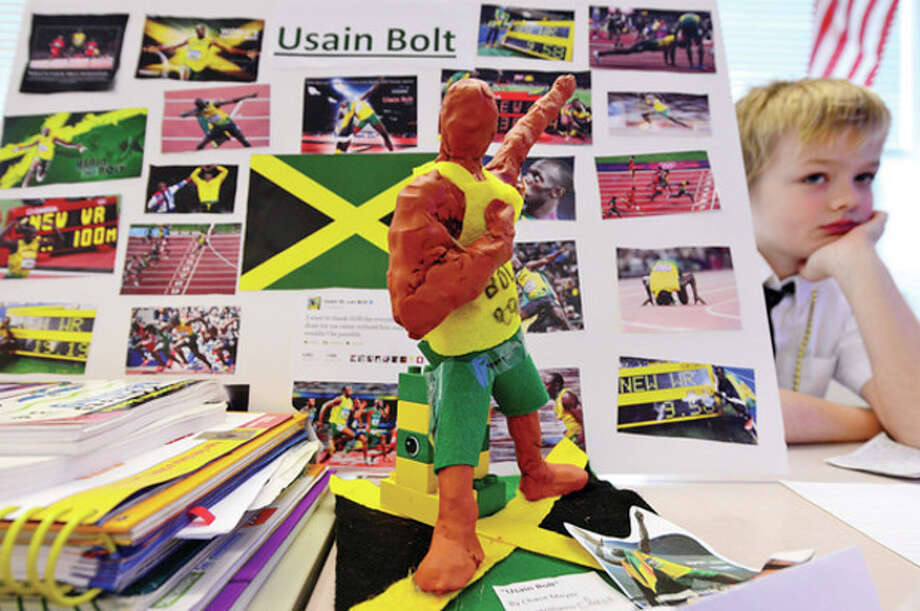 Chase Meyer has made a sculpture of historical figure and olympic runner Usian Bolt in Elizabeth Williams' All Saints' Catholic School third-grade class. / (C)2012, The Hour Newspapers, all rights reserved