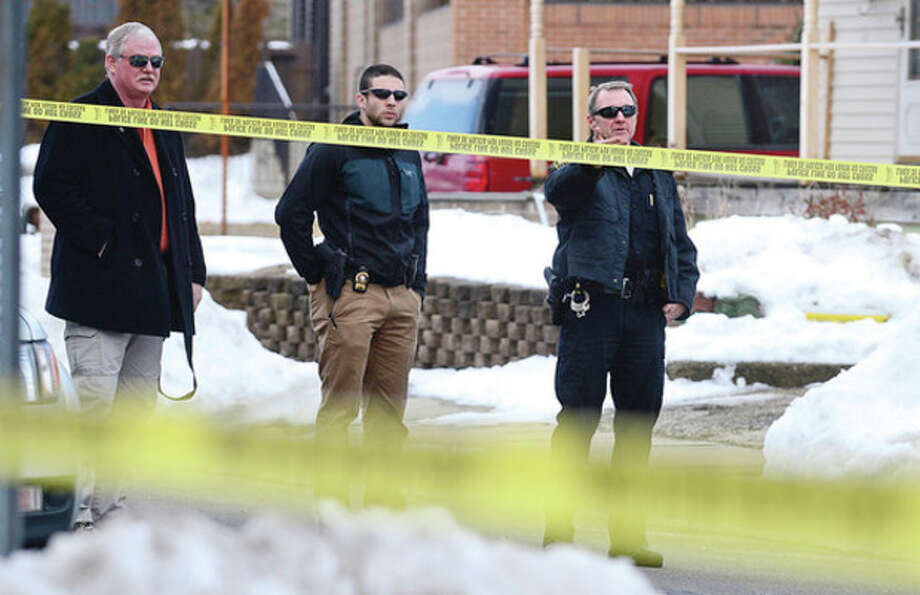 Norwalk police investigate a shooting that occurred on Day St. Tuesday at noon.Hour photo / Erik Trautmann / (C)2012, The Hour Newspapers, all rights reserved