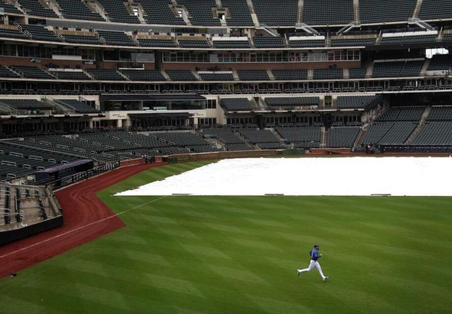 New York Mets starting pitcher Dillon Gee works out in an empty Citi Field after their baseball game against the San Francisco Giants was postponed due to weather, Sunday, April 22, 2012, in New York. A spring nor'easter along the East Coast is expected to bring rain and heavy winds and even snow in some places as it strengthens into early Monday, a punctuation to a relatively dry stretch of weather for the Northeast. (AP Photo/Seth Wenig) / AP