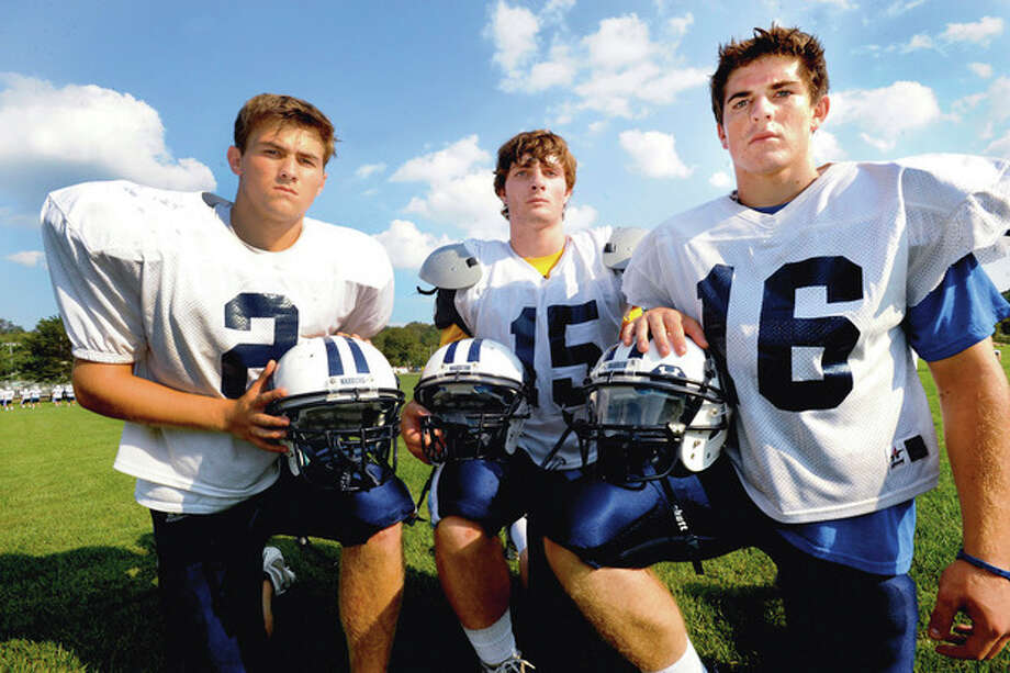 Photo by Matthew Vinci Wilton High School football senior captains, from left, Brendan Chapey, Connor Devane and Sean Carroll will lead the Warriors through the 2011 season. / (C)2011, The Hour Newspapers, all rights reserved