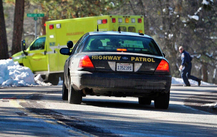 Law enforcement officials respond after Christopher Dorner, the fugitive ex-Los Angeles cop sought in three killings, engaged in a shootout with authorities that wounded two officers in the San Bernardino Mountains near Big Bear Lake, Calif., Tuesday, Feb. 12, 2013. (AP Photo/The Sun, Rachel Luna) VENTURA COUNTY STAR OUT; RIVERSIDE PRESS-ENTERPRISE OUT; THE VICTOR VALLEY DAILY PRESS OUT / San Bernardino Sun