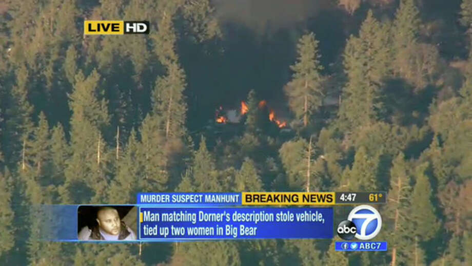 In this image taken from video provided by KABC-TV, the cabin in Big Bear, Calif. where ex-Los Angeles police officer Christopher Dorner is believed to be barricaded inside is in flames Tuesday, Feb. 12, 2013. (AP Photo/KABC-TV) MANDATORY CREDIT: KABC-TV / KABC-TV