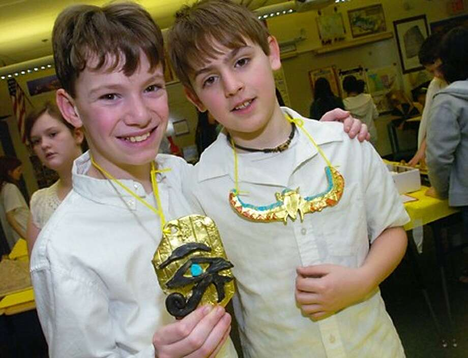 "MIddbrook Middle School 6th graders Chris McKay and Alec Biegen display egyptian jewelry made for the museum of artifacts as part of the class''s celebration, ""The Mysteries of Egypt"" that was on view for teachers and parent Friday at the school. Hour photo / Erik Trautmann"