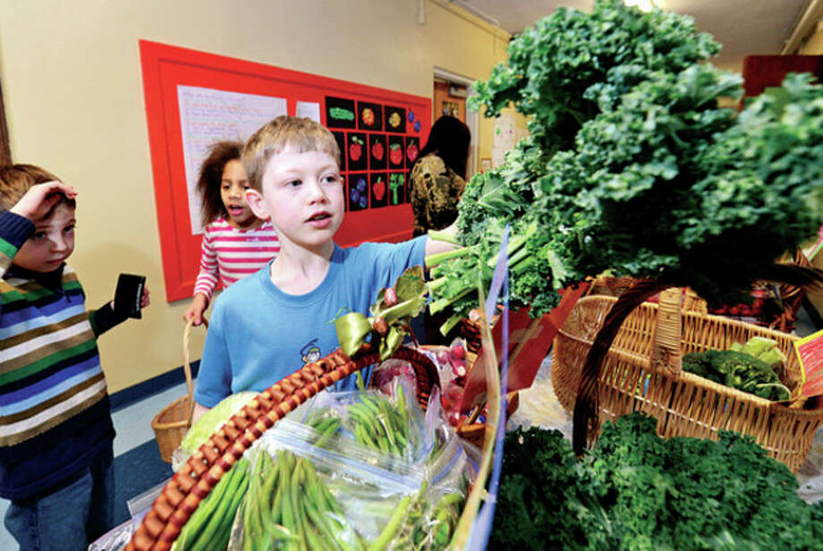 Columbus Magnet School 2nd grader Ben Welte participates in the school's annual first grade Big Bag Market where students learn business skills Wednesday. The market continues Thursday and Friday 9am to 11.Hour photo / Erik Trautmann / (C)2012, The Hour Newspapers, all rights reserved