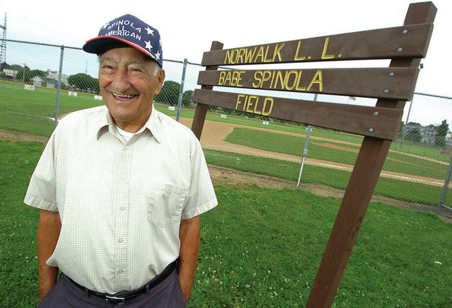 Hour Photo/Alex von Kleydorff Babe Spinola stands in front of the sign that identifies the Norwalk Little League field named for him. A longtime coach and administrator in what became known as the Babe Spinola American Little League, SpinolaÕs name has become synonymous with Little League in Norwalk / 2011 The Hour Newspapers