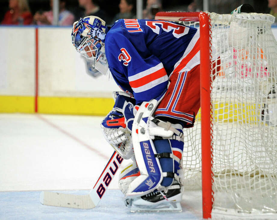 New York Rangers goaltender Henrik Lundqvist, of Sweden, reacts during the third period of Game 5 of an NHL Stanley Cup first-round hockey playoff series against the Ottawa Senators, Saturday, April 21, 2012, at New York's Madison Square Garden. The Senators won 2-0 to lead the series 3-2. (AP Photo/Bill Kostroun) / FR51951 AP
