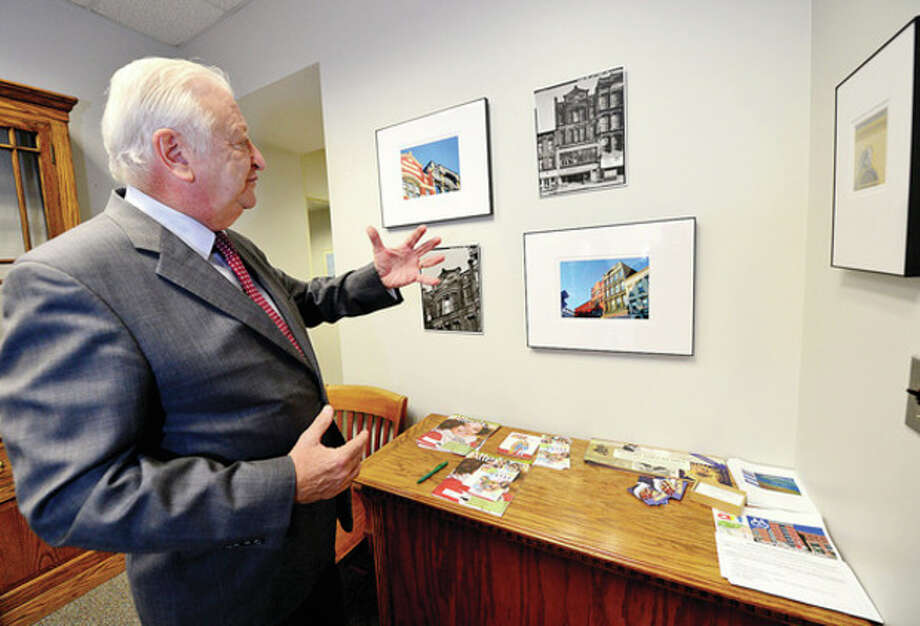 "Hour photo / Erik TrautmannNorwalk Mayor Richard A. Moccia comments on the upcoming exhibit, ""Consolidation of Norwalk 1913-2013"" a historical walk through time, in the Mayor's Gallery at the Norwalk City Hall. / (C)2012, The Hour Newspapers, all rights reserved"