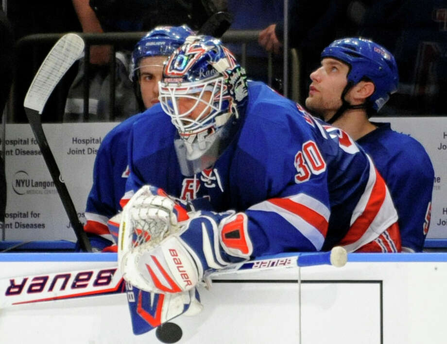 New York Rangers goaltender Henrik Lundqvist, of Sweden, looks on from the bench during the third period of Game 5 of an NHL Stanley Cup first-round hockey playoff series against the Ottawa Senators, Saturday, April 21, 2012, at New York's Madison Square Garden. The Senators won 2-0 to lead the series 3-2. (AP Photo/Bill Kostroun) / FR51951 AP