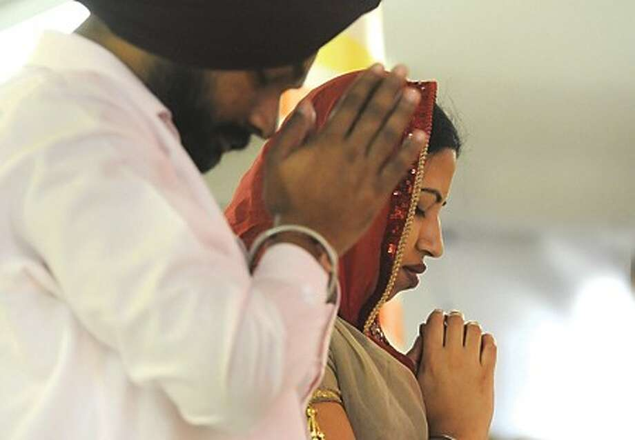 Kanwaljeet Singh and Pushpinder Kaur at the Gurdwara Sikh Temple in Norwalk where the Sikh New Year was celebrated on Thursday. hour photo/matthew vinci