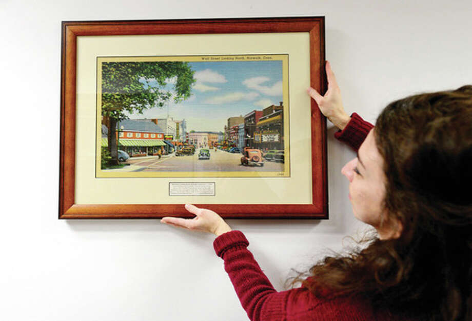"@Brown=[C]Hour photo / Erik TrautmannSooo-z Mastropietro curates ""Consolidation of Norwalk 1913-2013"" a historical walk through time, in the Mayor's Gallery at the Norwalk City Hall. / (C)2012, The Hour Newspapers, all rights reserved"