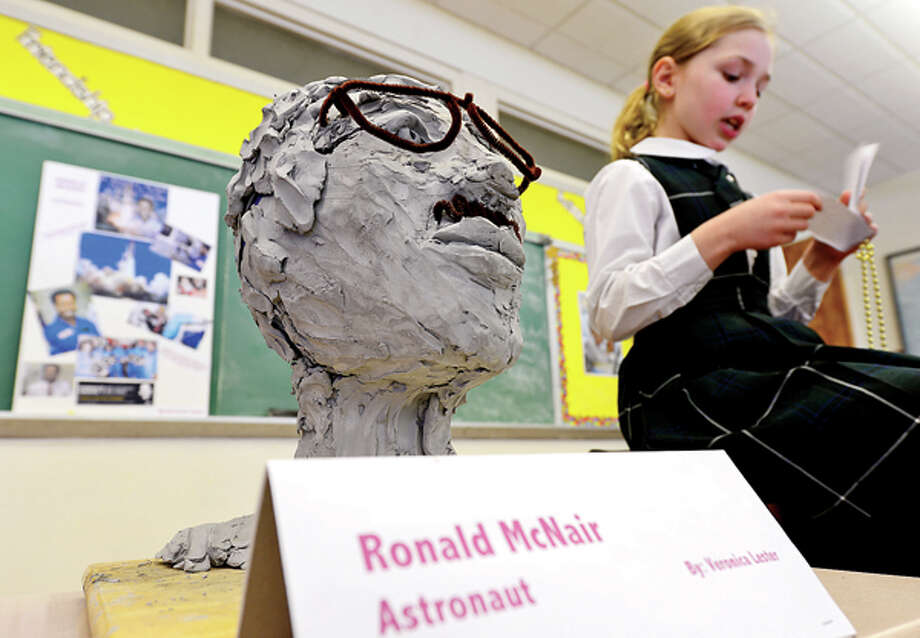 Veronica Lester has made a bust of astronaut Ronald McNair and gives her report on the black historical figure during Elizabeth Williams All Saints Catholic School 3rd grade class in honor of Black History month Tuesday. Hour photo / Erik Trautmann / (C)2012, The Hour Newspapers, all rights reserved