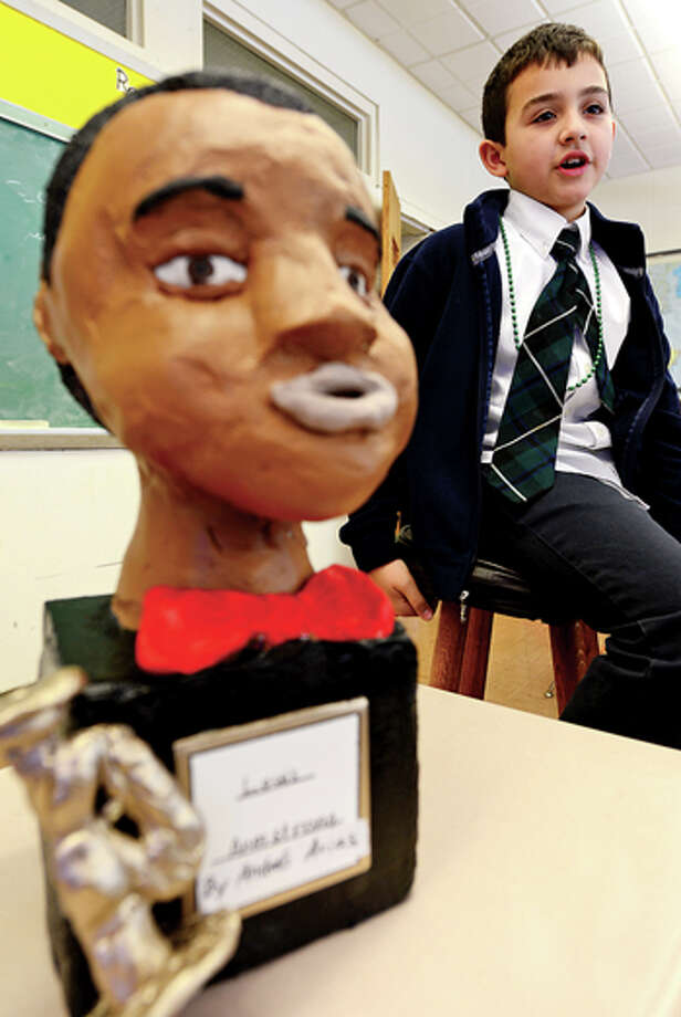 Andre Arias has made a bust of musician Louis Armstrong and gives hisreport on the black historical figure during Elizabeth Williams All Saints Catholic School 3rd grade class in honor of Black History month Tuesday. Hour photo / Erik Trautmann / (C)2012, The Hour Newspapers, all rights reserved