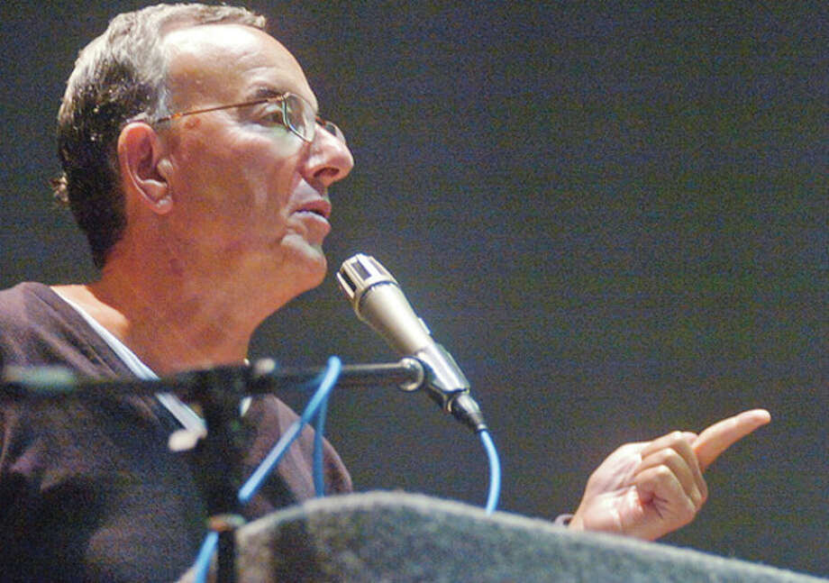 "Hour photos / Erik TrautmannCardiologist Dr. Edward Schuster lectures on ""How to Live to be 100"" at Norwalk Community College Friday. / (C)2011, The Hour Newspapers, all rights reserved"