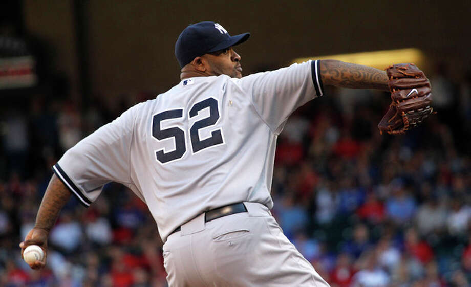 New York Yankees starting pitcher CC Sabathia throws during the first inning of a baseball game against the Texas Rangers, Monday, April 23, 2012, in Arlington, Texas. (AP Photo/LM Otero) / AP