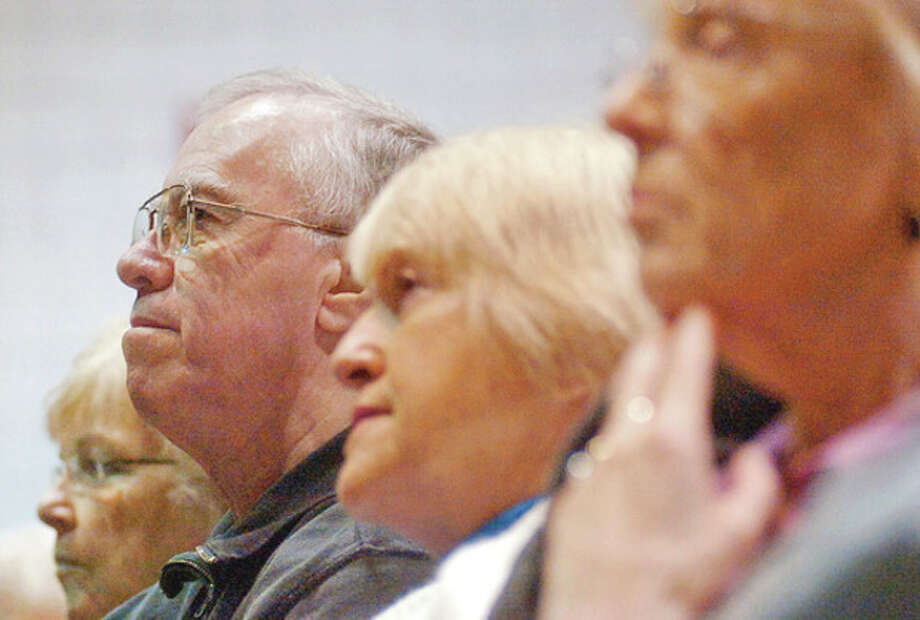 Audience members listen to a lecture by cardiologist Dr. Edward Schuster at Norwalk Community College. / (C)2011, The Hour Newspapers, all rights reserved