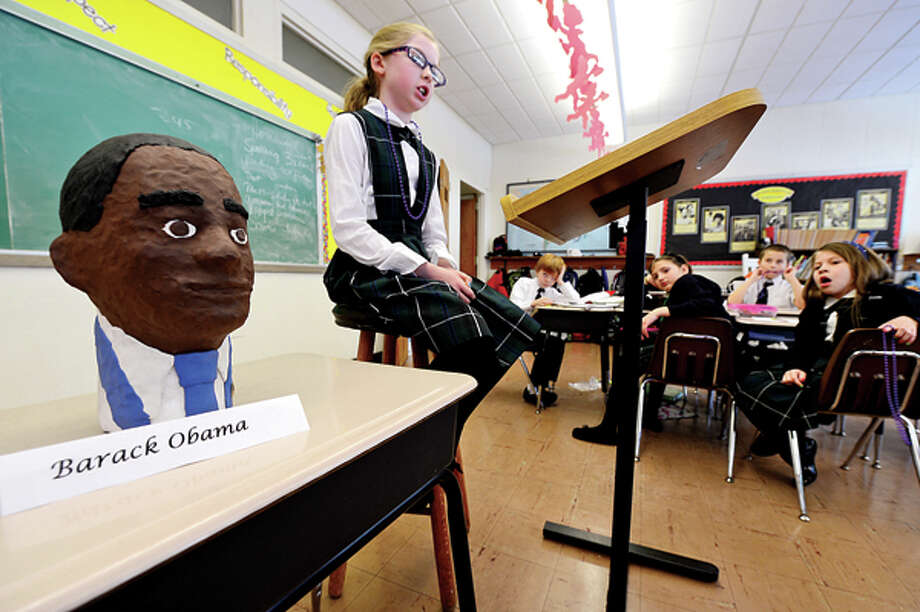 Ella Corry made a bust of historical figure Barack Obama and gives her report in Elizabeth Williams All Saints Catholic School 3rd grade class in honor of Black History month Tuesday. Hour photo / Erik Trautmann / (C)2012, The Hour Newspapers, all rights reserved