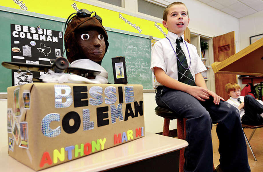 Anthony Marini has made a bust of aviator Bessie Coleman and gives his report on the black historical figure during Elizabeth Williams All Saints Catholic School 3rd grade class in honor of Black History month Tuesday. Hour photo / Erik Trautmann / (C)2012, The Hour Newspapers, all rights reserved