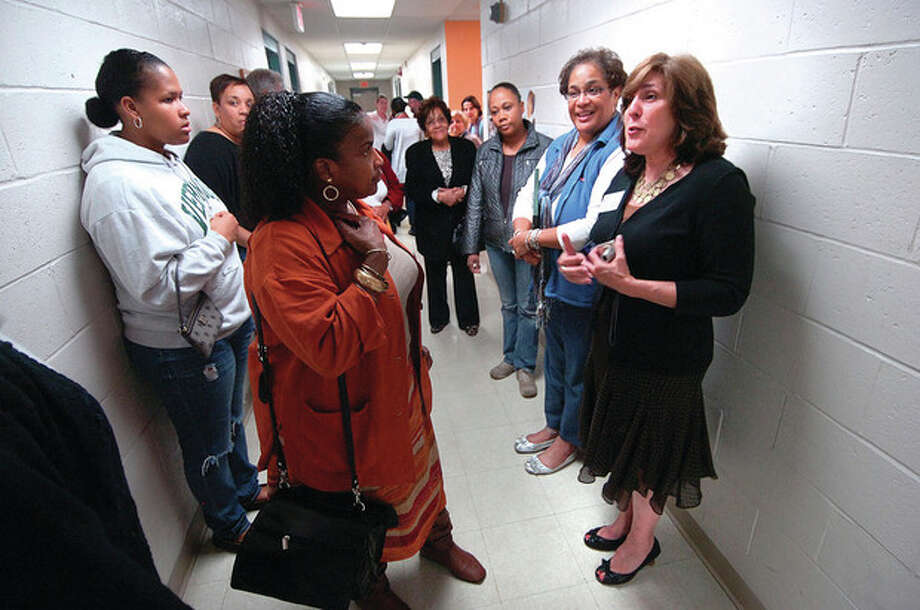 Hour Photo/ Alex von Kleydorff. Dr Robert E. Appleby School Based Health Center Director Rhonda Capuano on right starts a tour of the new center at Briggs High School / 2011 The Hour Newspapers/ Alex von Kleydorff