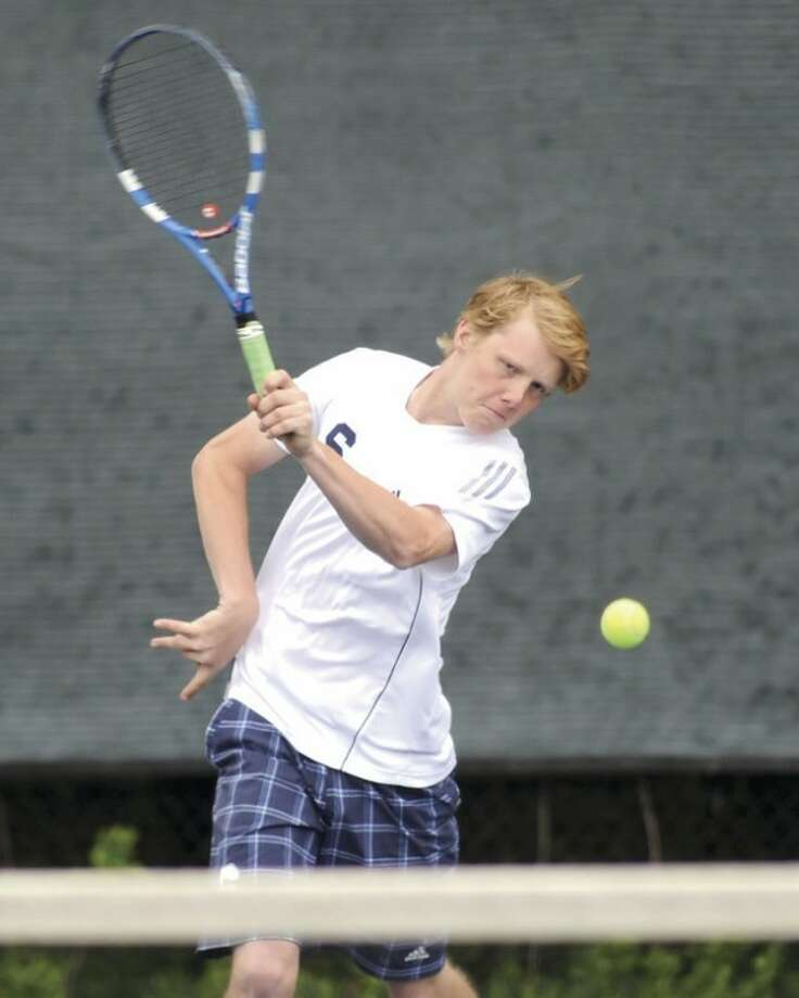 Hour photo/John NashStaples High School's Steve Thomson hits a return during his first doubles match against Wilton on Monday in Westport. The unbeaten Wreckers prevailed, 6-1.