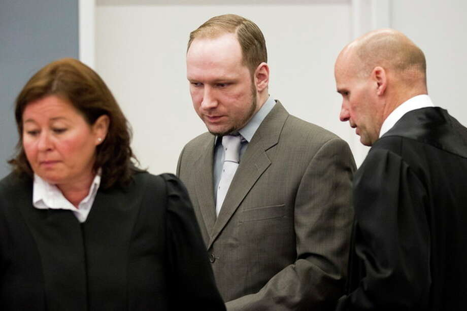 """Terror- and murder charged Anders Behring Breivik arrives in the courtroom in Oslo Tuesday April 24, 2012. He is flanked by his defence lawyers Geir Lippestad, right, and Vibeke Hein Baera. Confessed mass killer Anders Behring Breivik vehemently defended his sanity after a forensic panel found flaws in a psychiatric report that declared him sane in the eyes of the law. As the trial for Breivik's bomb-and-shooting rampage that killed 77 people entered its second week, Monday, the far-right fanatic told a court that he was the victim of a """"racist"""" plot to discredit his ideology. He said no one would have questioned his sanity if he were a """"bearded jihadist."""" (AP Photo/Fredrik Varfjell, Pool) / POOL NTB Scanpix"""