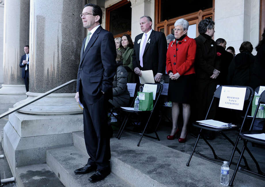 Connecticut Gov. Dannel P. Malloy waits to speak during a rally at the Capitol in Hartford, Conn., Thursday, Feb. 14, 2013. Thousands of people turned out to call on lawmakers to toughen gun laws in light of the December elementary school shooting in Newtown that left 26 students and educators dead. (AP Photo/Jessica Hill) / FR125654 AP