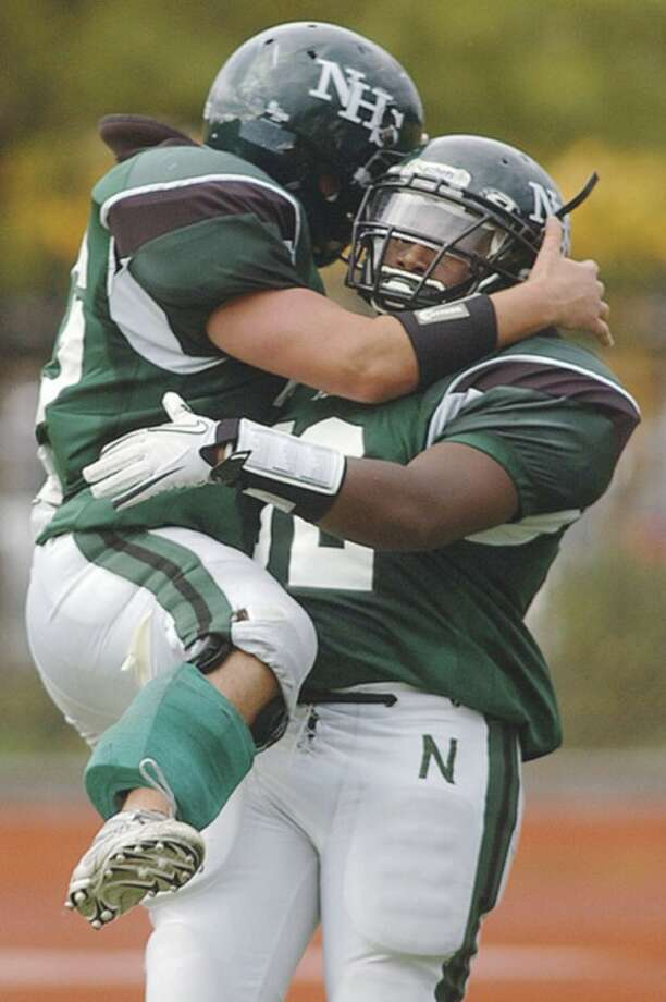 Hour photo/Erik Trautmann Dave Klein leaps into the arms of Norwalk running back Tomar Joseph after Joseph scored one of his two touchdowns in the Bears' 42-13 victory over Westhill Saturday afternoon at Testa Field. Joseph returned to action against the Vikings after missing last weekend's victory over Stamford.