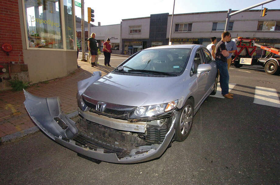 Hour Photo/ Alex von Kleydorff. A Honda involved in a multi vehicle wreck on Wall st. / The Hour Newspapers