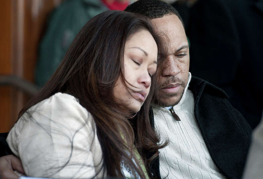 Robert Thompson, right, and his wife Nikki Thompson, parents of shooting victim Justin Thompson 14, of Bridgeport, embrace during a rally at the Capitol in Hartford, Conn., Thursday, Feb. 14, 2013. Thousands of people turned out to call on lawmakers to toughen gun laws in light of the December elementary school shooting in Newtown that left 26 students and educators dead. (AP Photo/Jessica Hill) / FR125654 AP