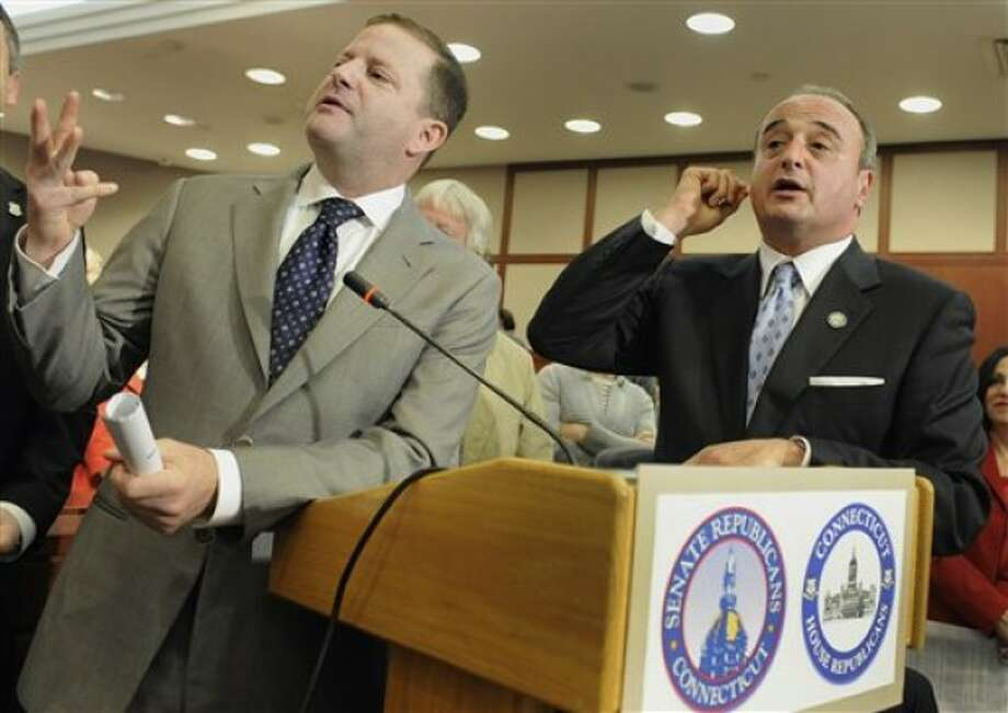 Connecticut Senate Minority Leader John McKinney, R-Fairfield, left, and House Minority Leader Lawrence Cafero, R-Norwalk, speak during a news conference to unveil the Republican''s alternative budget at the Legislative Office Building in Hartford, Conn., Tuesday, April 19, 2011. The Republican state budget proposal doesn''t raise taxes and calls for cutting the state employee workforce by five percent. (AP Photo/Jessica Hill)