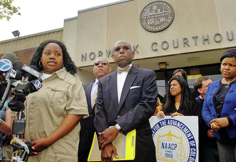 Tanya McDowell, who was charged with fraud after she allegedly enrolled her son the Norwalk Public Schools, commenst with her attorney Darnell Crosdale during a press conference outside Norwalk Superior Court Wednesday morning. / (C)2011, The Hour Newspapers, all rights reserved
