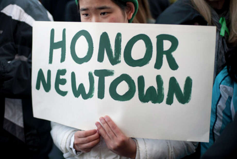 Ap photoAleena Nicoloro holds a sign during a rally in Hartford. / FR125654 AP