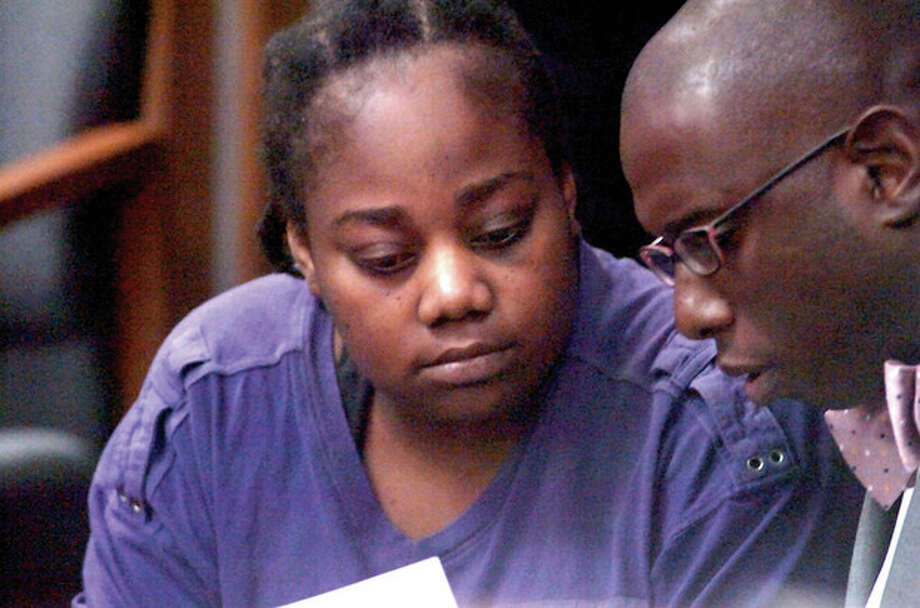 Photo Alex von Kleydorff. Tanya McDowell confers with her attorney Darnell D. Crossland during her arraignment hearing Monday June 13 in Norwalk Ct. Superior Court. / (C)2011, The Hour Newspapers, all rights reserved