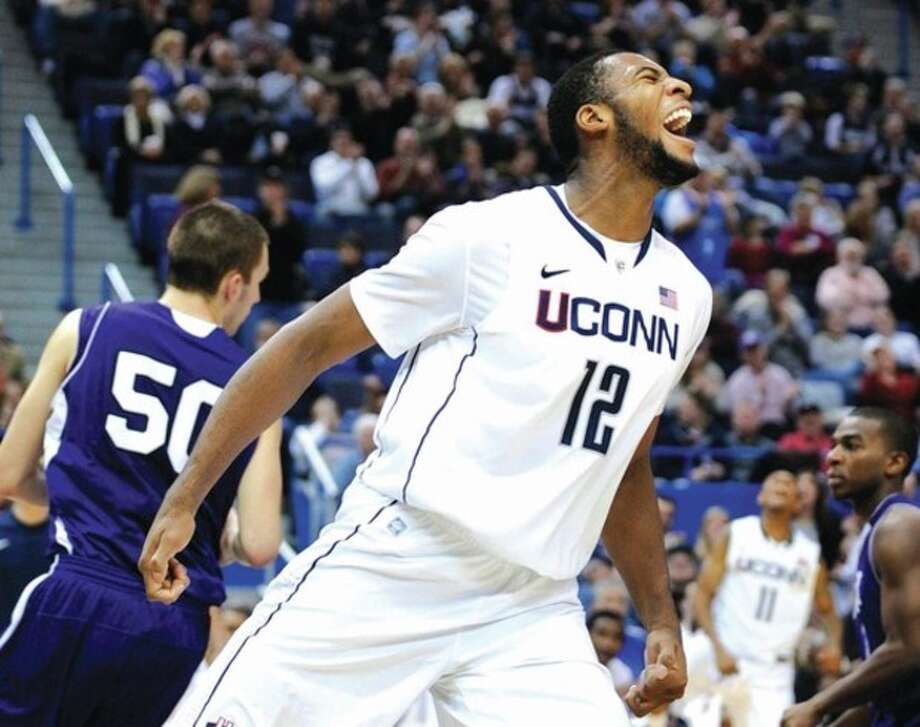 AP photo UConn's Andre Drummond celebrates during the second half of Sunday's win over Holy Cross. Drummond has revealed that he declined a scholarship and is playing as a walk-on on the basketball team. / FR153656 AP