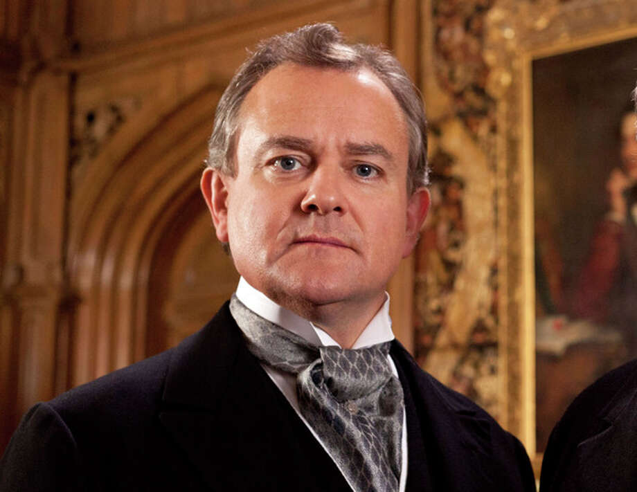 "This publicity image released by PBS shows Hugh Bonneville in a scene from the popular series ""Downton Abbey."" Bonneville portrays the patriarchal Lord Grantham in the series, ""Downton Abbey."" The season three finale airs Sunday, Feb., 17 on PBS. (AP Photo/PBS, Josh Barratt) / PBS"