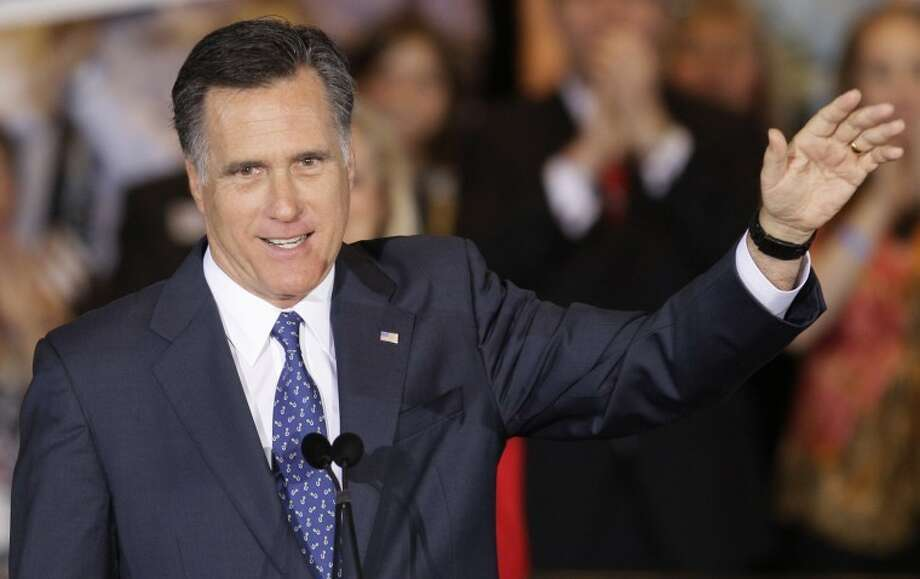 Republican presidential candidate, former Massachusetts Gov. Mitt Romney waves as he speaks at an election night event in Schaumburg, Ill., Tuesday, March 20, 2012. Romney won Illinois Primary. (AP Photo/Nam Y. Huh)
