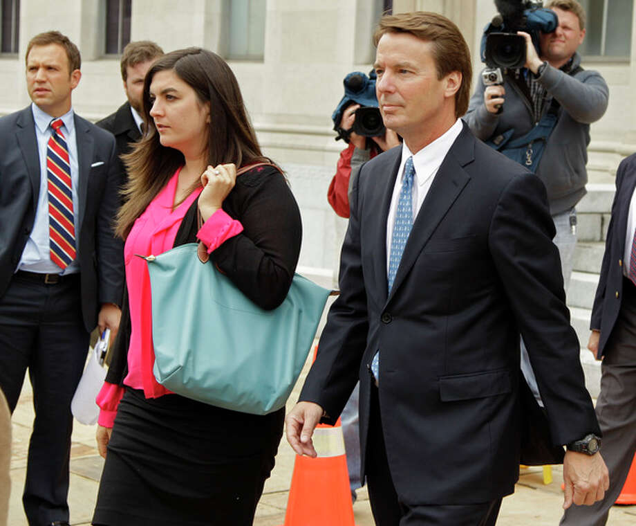 Former presidential candidate and U.S. Sen. John Edwards, right, leaves a federal court with his daughter Cate, left, in Greensboro, N.C., Monday, April 23, 2012. A former aide to Edwards has taken the witness stand in his criminal trial to testify about his role in allegedly violating campaign finance laws to cover up an extramarital affair. (AP Photo/Chuck Burton) / AP