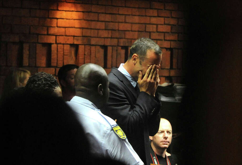 Athlete Oscar Pistorius weeps in court in Pretoria, South Africa, Friday, Feb 15, 2013, at his bail hearing in the murder case of his girlfriend Reeva Steenkamp. Oscar Pistorius arrived at a courthouse Friday, for his bail hearing in the murder case of his girlfriend as South Africans braced themselves for the latest development in a story that has stunned the country. The Paralympic superstar was earlier seen leaving a police station in a dark suit with a charcoal gray jacket covering his head as he got into a police vehicle. Model Reeva Steenkamp was shot and killed at Pistorius' upmarket home in an eastern suburb of the South African capital in the predawn hours of Thursday. (AP Photo/Antione de Ras - Independent Newspapers Ltd South Africa) SOUTH AFRICA OUT / INLSA